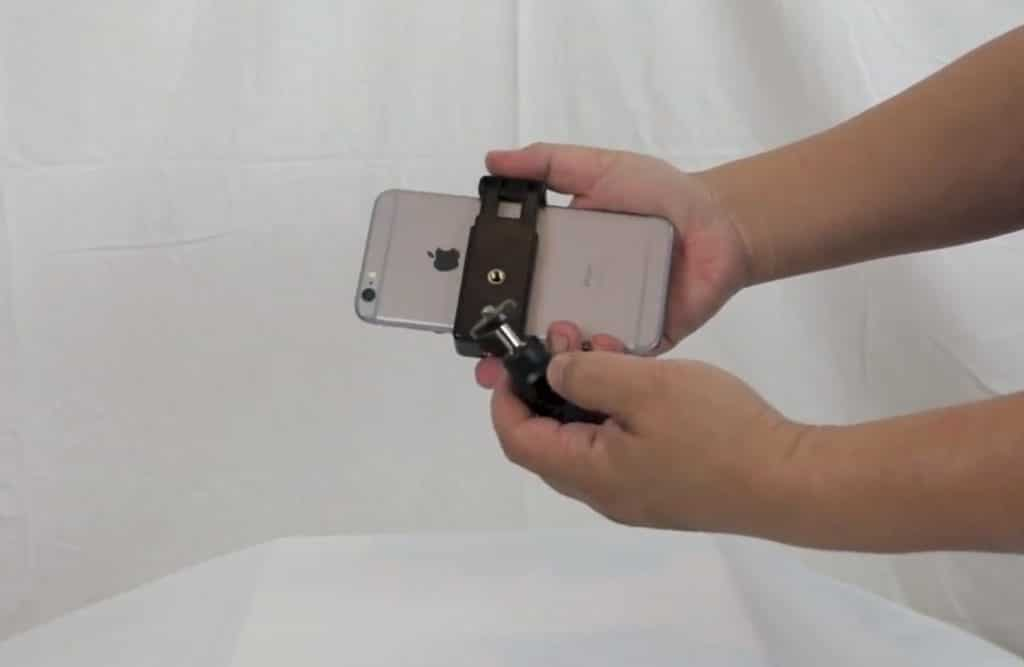 clip dispositivo para teléfonos en aros de luz